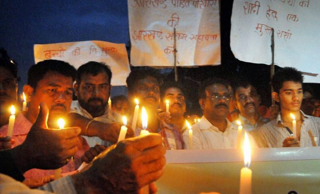 People paying tribute to the victims of Uttarakhand flood disaster on its first anniversary ...