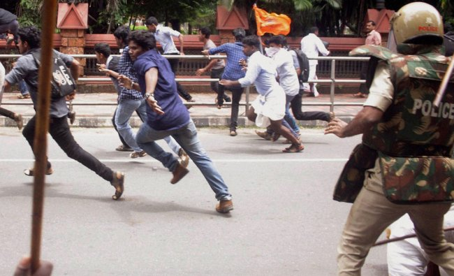 Police disperse ABVP workers protesting at DDE office in Kozhikode, Kerala ...
