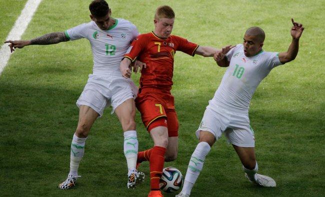Algeria\'s Carl Medjani, Belgium\'s Kevin De Bruyne and Algeria\'s Sofiane Feghouli fight for ball ...