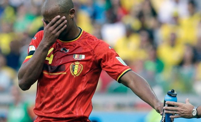 Belgium\'s Vincent Kompany takes on refreshment during the group H World Cup soccer match ...