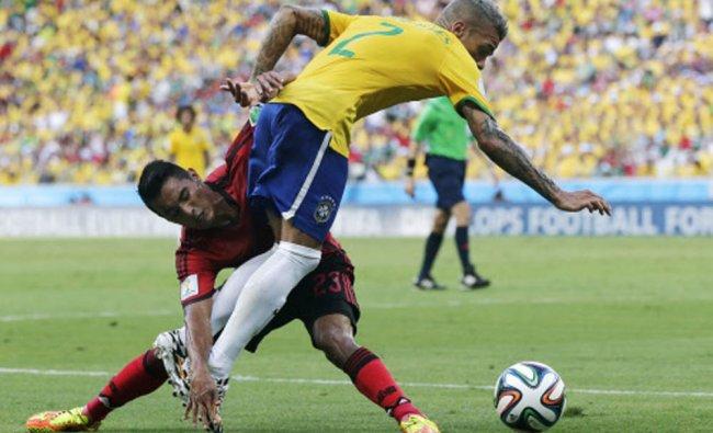 Brazil\'s Neymar trips over Mexico\'s Jose Juan Vazquez ...
