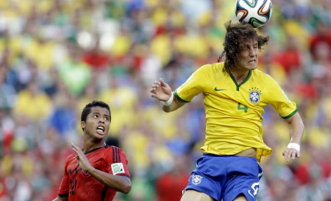 Brazil\'s David Luiz clears the ball watched by Mexico\'s Giovani dos Santos ...