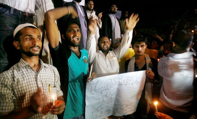 Muslims holding a candle light demonstration over Iraq issue at Jantar Mantar ...