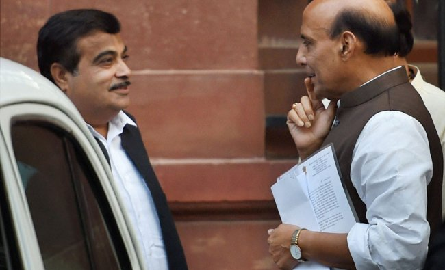 Rajnath Singh and Road Transport and Highways Minister Nitin Gadkari after a Cabinet meeting ...