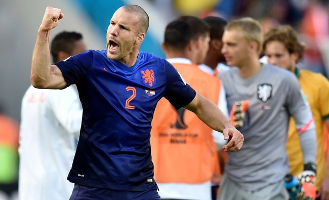 Netherlands\' Ron Vlaar celebrates after the group B World Cup soccer match ...