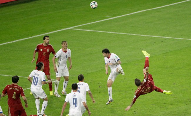Spain\'s Sergio Ramos performs a bicycle kick during the group B World Cup soccer match ...