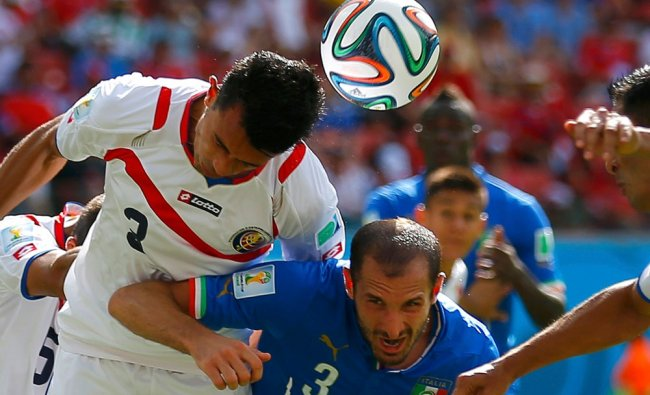 Italy\'s Chiellini fights for the ball with Costa Rica\'s Gonzalez ...