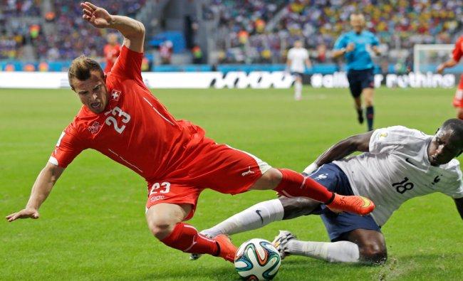 Switzerland\'s Xherdan Shaqiri is tripped by France\'s Moussa Sissoko ...