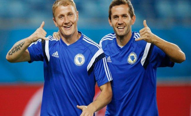 Bosnia\'s national team players Senad Lulic and Senijad Ibricic gesture during a training session...