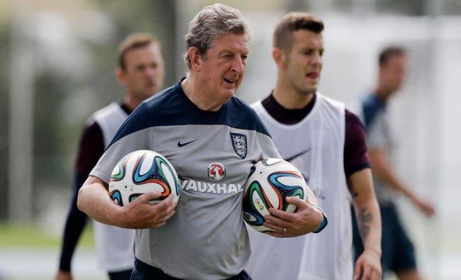England national soccer team head coach Roy Hodgson carries footballs during a squad training ...