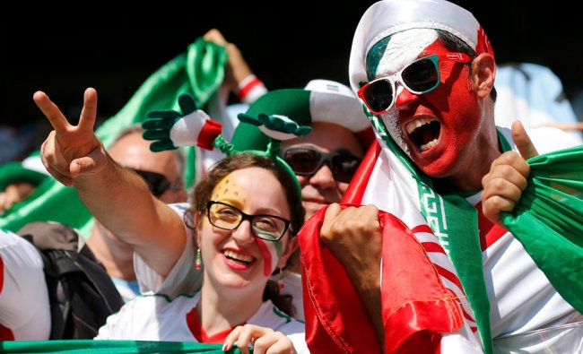 Fans of Iran cheer before their 2014 World Cup Group F soccer match against Argentina at the ...