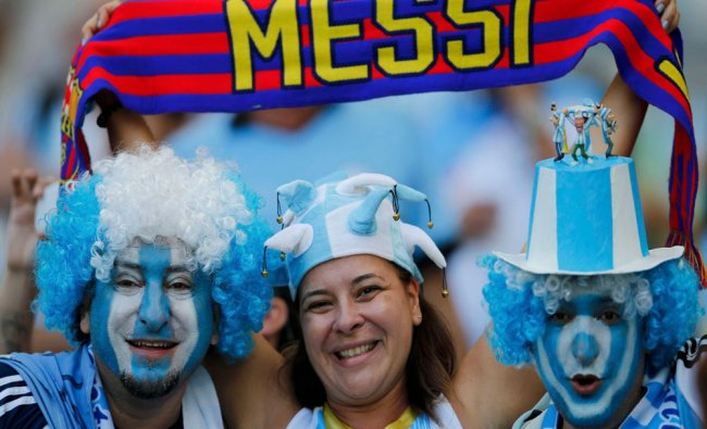 Fans of Argentina wait for the start of their 2014 World Cup Group F soccer match against Iran...