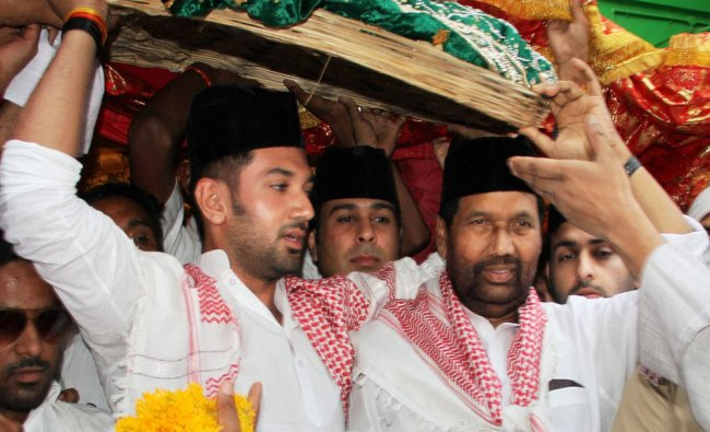 Union minister Ram Vilas Paswan with his son and MP Chirag Paswan offering a holy chadar at the...