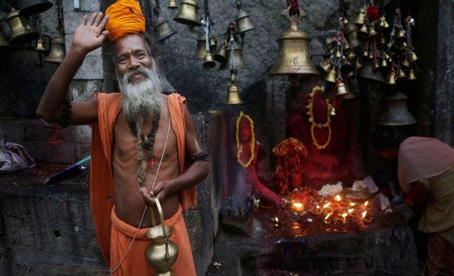 A Sadhu, waves to the camera at the Kamakhya temple in Gauhati, Saturday, June 21, 2014.AP photo
