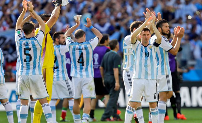 Argentina\'s Lionel Messi and his teammates applaud after their 1-0 victory over Iran during the...
