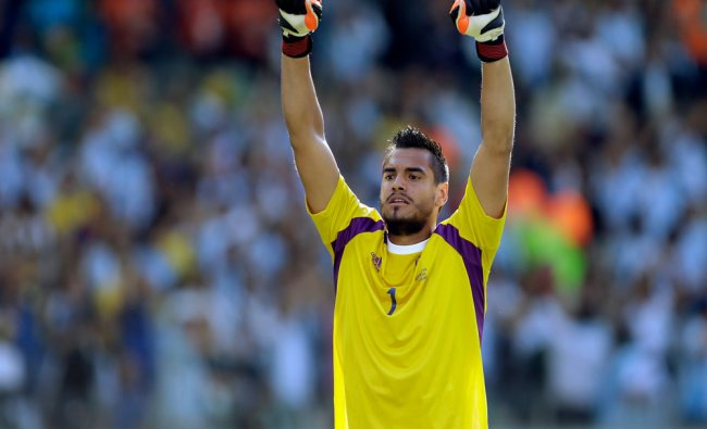 Argentina\'s goalkeeper Sergio Romero celebrates after their 1-0 victory over Iran during the...
