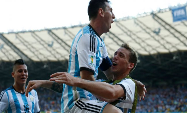 Argentina\'s Lionel Messi, second right, celebrates after scoring the first goal during the...