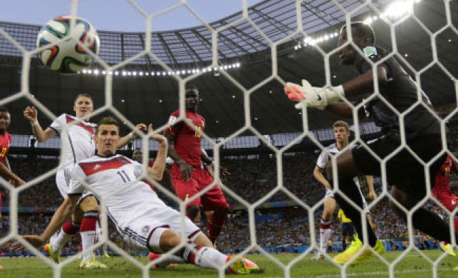 Germany\'s Miroslav Klose, center, scores his side\'s second goal during the group G World Cup...