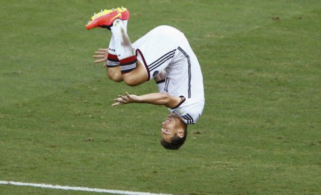 Germany\'s Miroslav Klose executes a sommersault as he celebrates scoring a goal against ...