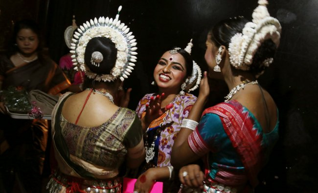 Dancers chats at the backstage before performing during a classical dance festival in Bangalore...