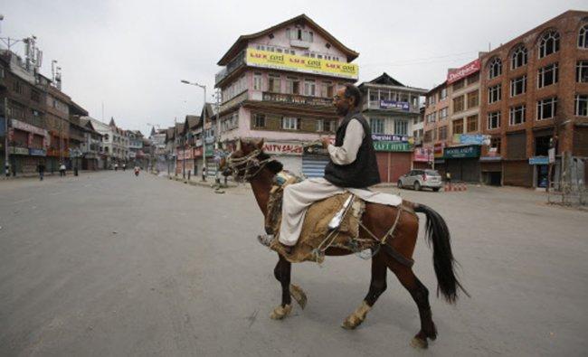 A Kashmir man rides on his horse during a strike called by JKLF in Srinagar...