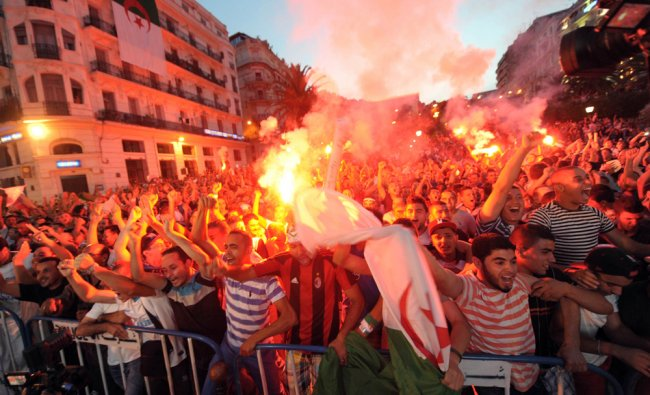 Algerian soccer fans burn flares as they celebrate their team\'s World Cup victory over South Korea..