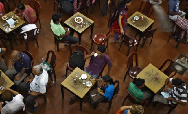 A customer drinks a cup of coffee inside an Indian coffee house in Kolkata June 20, 2014. If the...