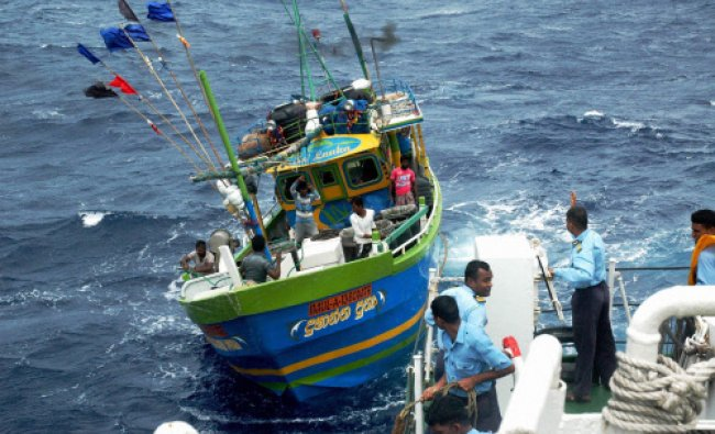Indian Coast Guard men seize a boat of Sri Lankan fishermen at the Indian waters of Bay of Bengal...