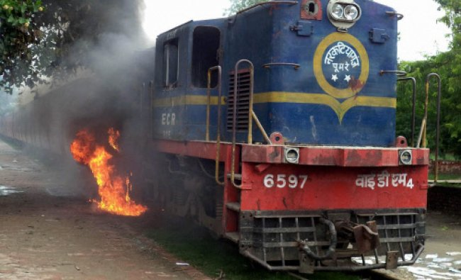 Angry mob burning a train after death of a student by a high voltage electric wire in Saharsa on...