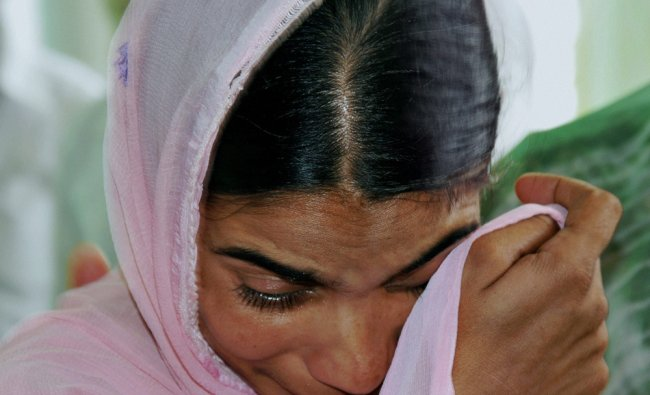 A relative breaks down during a prayer meeting for the Indian workers stranded in Iraq ...