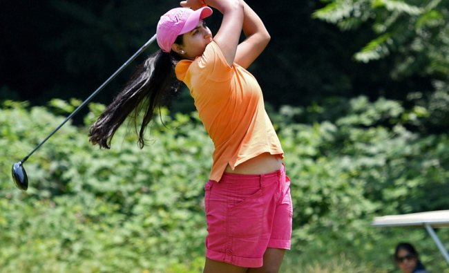 A player tees off during a golf event at Royal Spring Golf Course on the banks of Dal Lake ...