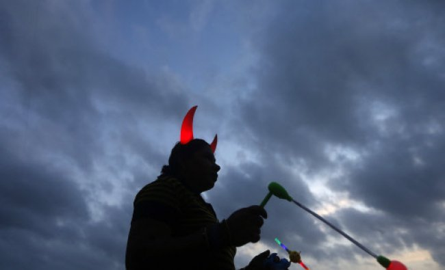 A vendor waits to sell toys to customers at his stall at Galle Face Green in Colombo June 24...
