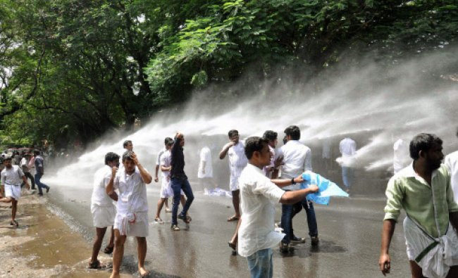 Police try to disperse members of Kerala Students Union using water canon after the students...