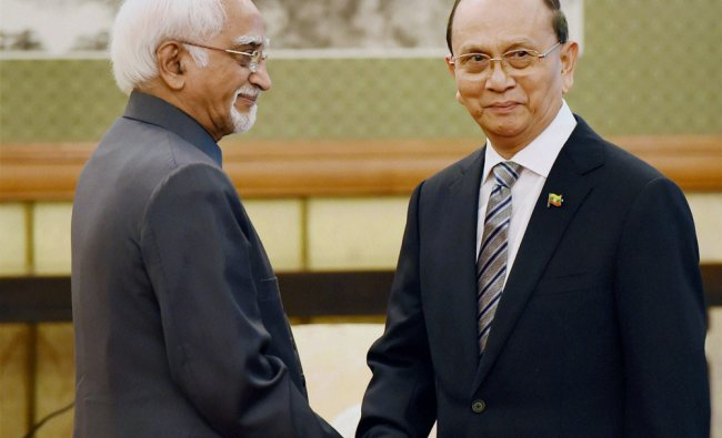 Vice President Hamid Ansari greets Myanmar President Thein Sein as he arrives for bilateral talk ...