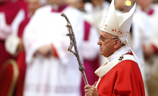 Pope Francis arrives to celebrate a mass where he bestowed the Pallium in Vatican ...
