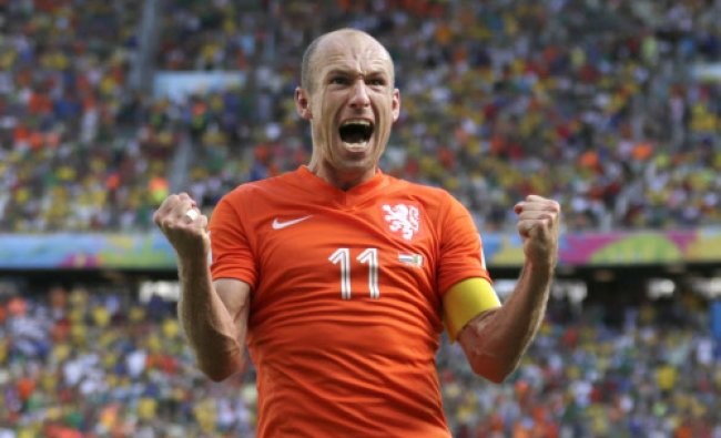 Netherlands\' Arjen Robben celebrates after the World Cup round of 16 soccer match between...