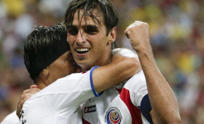 Costa Rica\'s Bryan Ruiz, right, celebrates after scoring his side\'s first goal during...