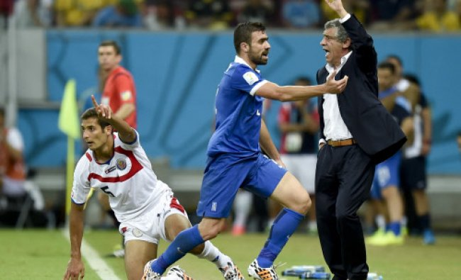 Greece\'s head coach Fernando Santos questions a call during the World Cup round of 16 socce...