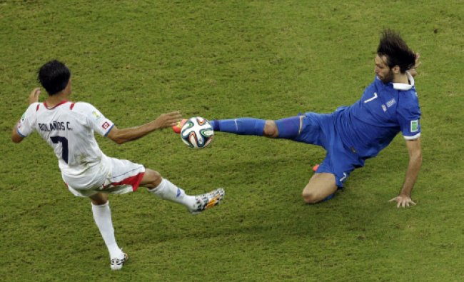 Greece\'s Sokratis Papastathopoulos, front, is challenged by Costa Rica\'s Joel Campbell during...
