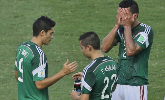 Mexico\'s Raul Jimenez, Paul Aguilar and Francisco Rodriguez shake hands after the World Cup round...