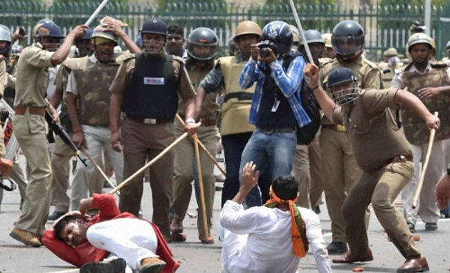 Police charge BJP Yuva Morcha activists during a protest outside Vidhan Bhawan in Lucknow...