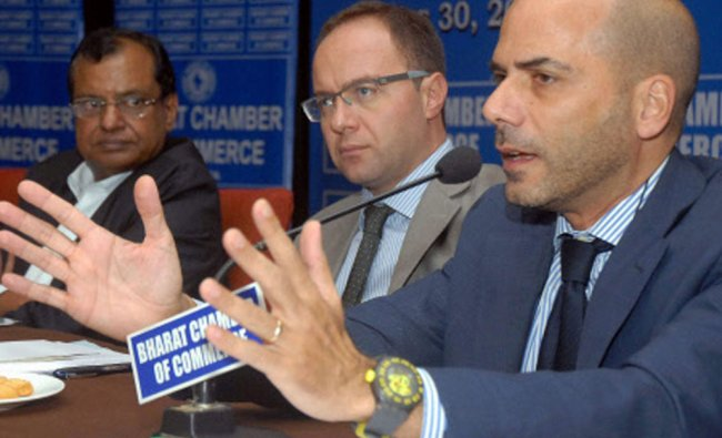 Amedeo Scarpa, Trade Commssioner of Italy in India speaks as Cesare Bieller (C), Consul General...