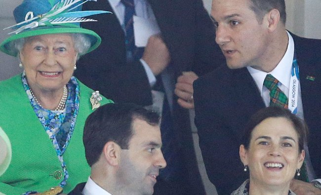 Britain\'s Queen Elizabeth II, back left, smiles as she...