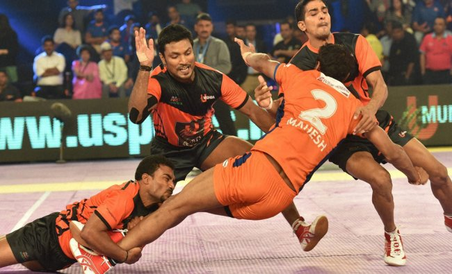 Kabaddi players of Bengaluru and Puneri Paltan in action during the match of Pro-Kabaddi league...
