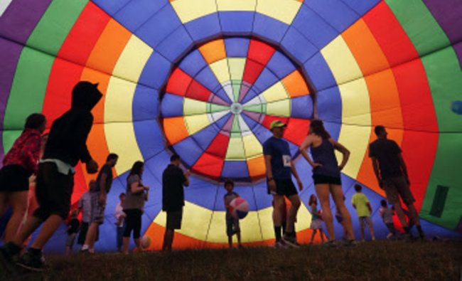 People walk around inside a partially inflated hot air balloon at the 32nd annual OuickChek....