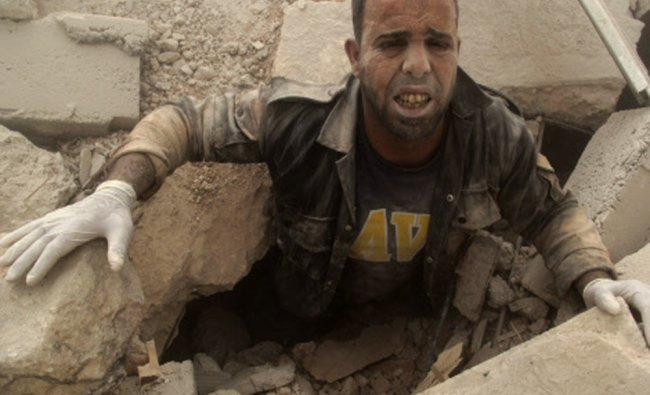 A civil defence member is stuck under debris at a site...