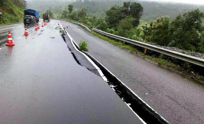 A crack seen on the highway caused by the erosion due to heavy rains at Kasara Ghat...