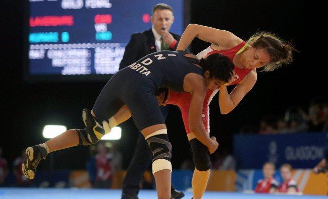 Babita Kumari wrestles with Canada\'s Brittanee Laverdure during the women\'s Freestyle...