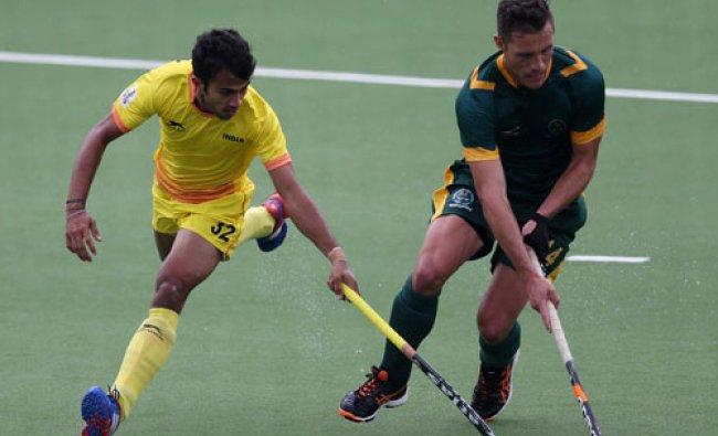 South Africa\'s Rhett Halkett, right, vies for the ball with India\'s Chandanda Nikkin, during...