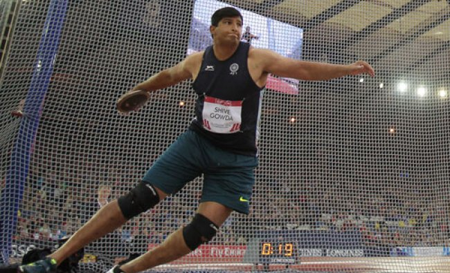 Gold medal winner Vikas Shive Gowda of India throws the discus in the final at Hampden Park...